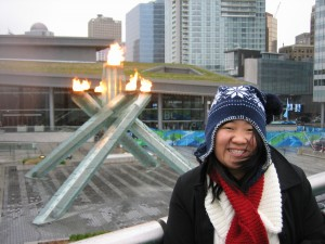 Angela in front of the Olympic torch